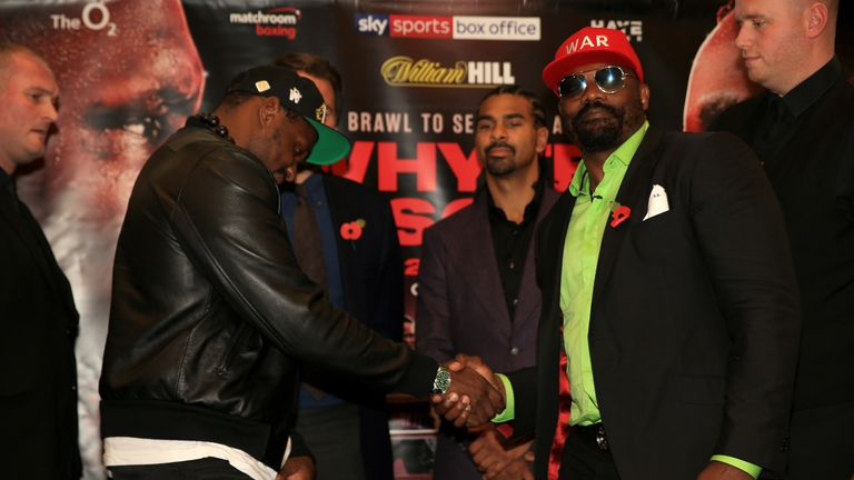 Dillian Whyte and Dereck Chisora shake hands during the Dillian Whyte Press Conference at the Canary Riverside Plaza Hotel on November 01, 2018 in London, England.