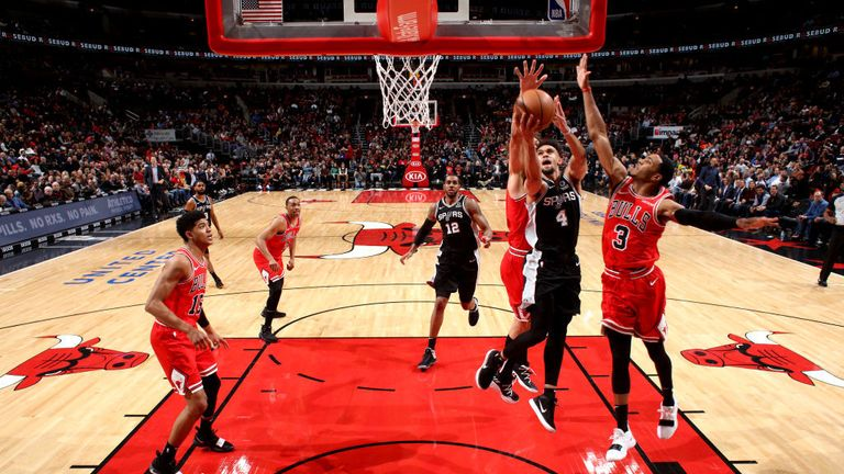 Derrick White #4 of the San Antonio Spurs shoots the ball against the Chicago Bulls on November 26, 2018 at the United Center in Chicago, Illinois.