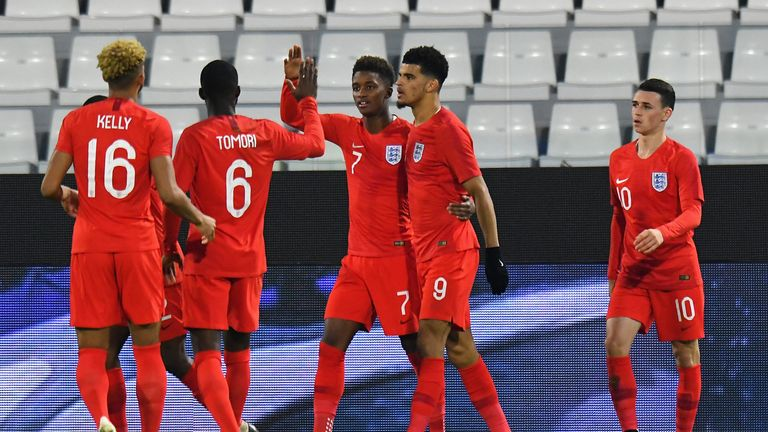 Dominic Solanke celebrates scoring his second goal for England U21 against Italy U21