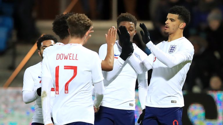 Dominic Solanke (right) celebrates scoring England U21s second goal