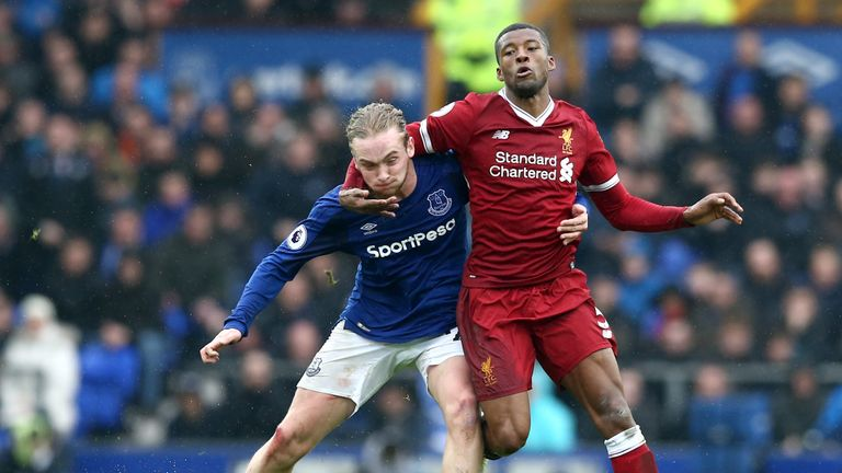 Georginio Wijnaldum and Tom Davies during the Premier League match between Everton and Liverpool at Goodison Park on April 7, 2018 in Liverpool, England.
