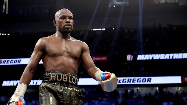 Floyd Mayweather Jr. walks to his corner while taking on Conor McGregor during their super welterweight boxing match on August 26, 2017 at T-Mobile Arena in Las Vegas, Nevada.