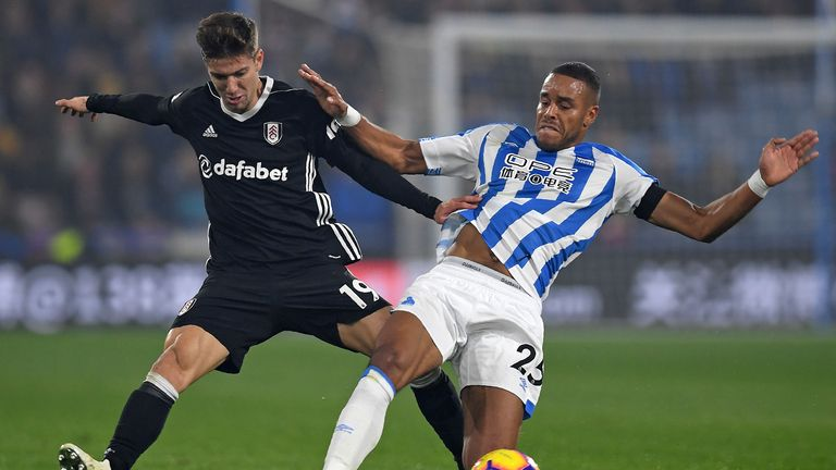 Fulham's Argentinian striker Luciano Vietto (L) vies with Huddersfield Town's Danish defender Mathias Jorgensen (R) during the English Premier League football match between Huddersfield Town and Fulham at the John Smith's stadium in Huddersfield, northern England on November 5, 2018.