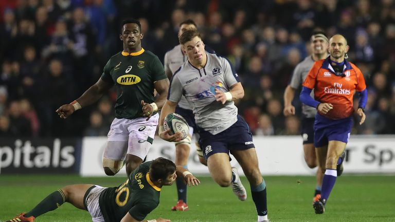 Huw Jones makes a fine break during a fiercely-competitive Test at Murrayfield