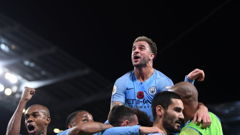 Ilkay Gundogan is mobbed by his Manchester City team-mates