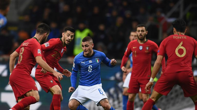 Portugal players surround Marco Verratti at the San Siro