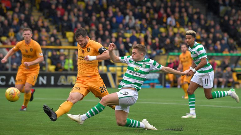 Livingston captain Craig Halkett puts pressure on James Forrest in the 0-0 draw against Celtic