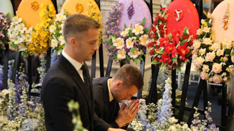 Jamie Vardy and Andy King of Leicester pay their respects at a Buddhist ceremony following the death of Vichai Srivaddhanaprabha