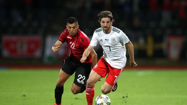 Joe Allen takes on Albania's Myrto Uzuni