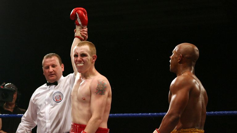 John Fewkes (centre) has his arm lifted by referee after points win over Gary Reid (right) during a bout at Doncaster Dome, Doncaster.