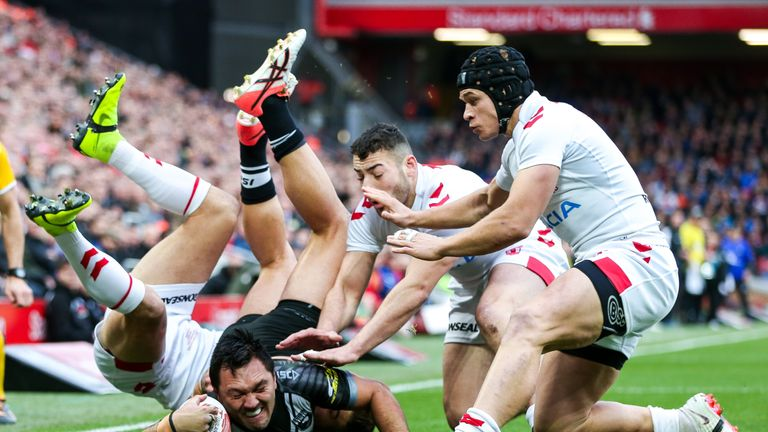 Jordan Rapana is tackled by England's Makinson, Jake Connor and Jonny Lomax