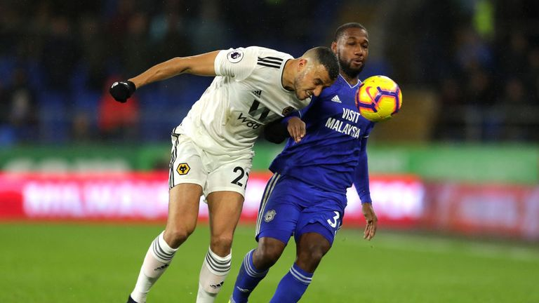 Junior Hoilett (right) tussles for the ball at the Cardiff City Stadium