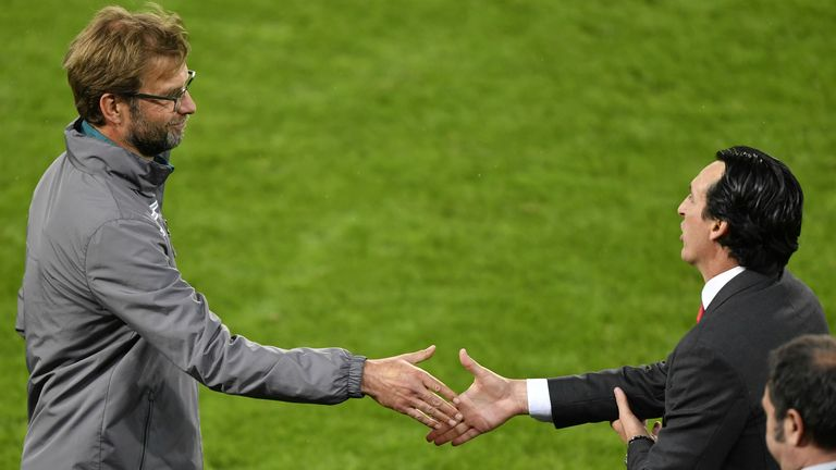 Sevilla's Spanish head coach Unai Emery (R) shakes hands with Liverpool's German head coach Jurgen Klopp after Sevilla won the UEFA Europa League final football match between Liverpool FC and Sevilla FC at the St Jakob-Park stadium in Basel, on May 18, 2016. AFP PHOTO / FABRICE COFFRINI / AFP / FABRICE COFFRINI (Photo credit should read FABRICE COFFRINI/AFP/Getty Images)