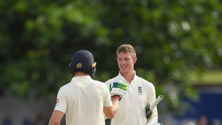 Keaton Jennings is congratulated by Jos Buttler after reaching his century