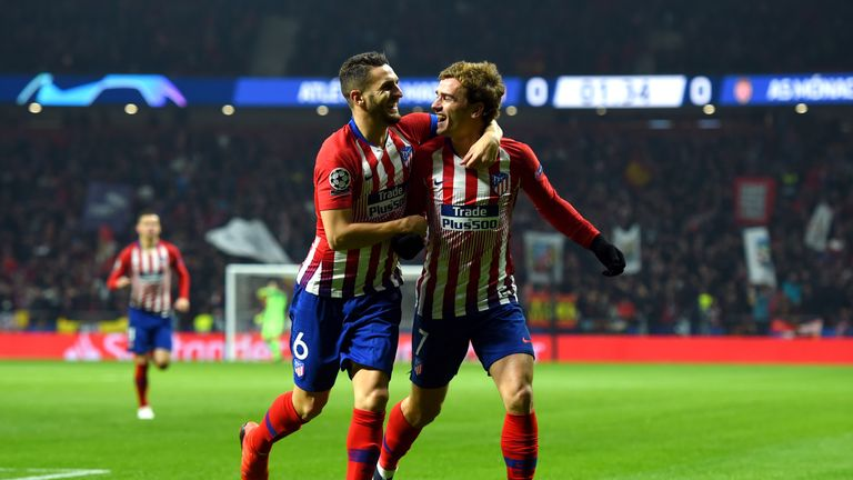 Koke celebrates his early goal with Antoine Griezmann