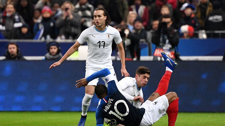 France's Kylian Mbappe falls down during the friendly football match France vs Uruguay, on November 20, 2018 at the Stade de France in Saint-Denis, outside Paris