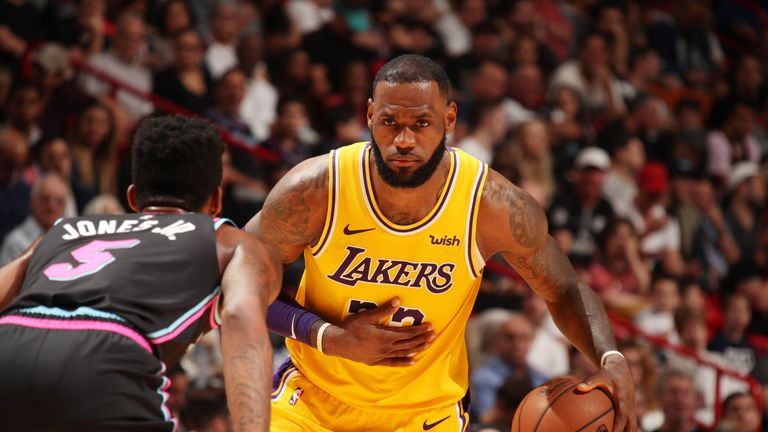 LeBron James #23 of the Los Angeles Lakers handles the ball against the Miami Heat on November 18, 2018 at American Airlines Arena in Miami, Florida.