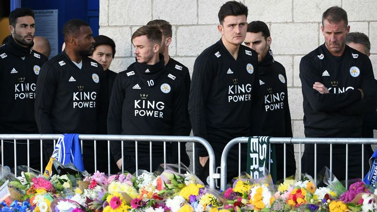 The Leicester City players visit the memorial outside the King Power Stadium
