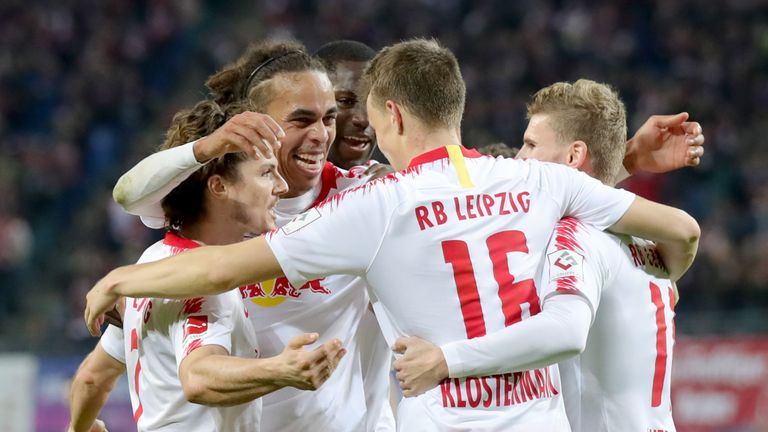 Lukas Kostermann  of Leipzig celebrates with his team mates, Marcel Sabnitzer (L), Yussuf Poulsen (2nd L) and Timo Werner (R)