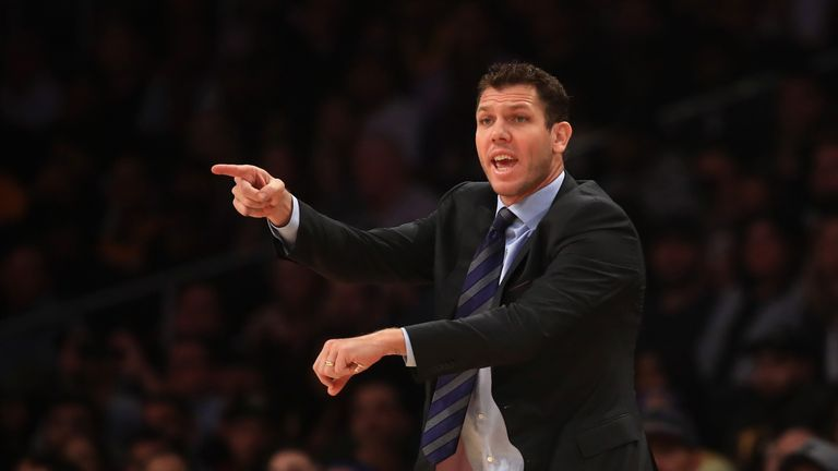 Lakers head coach Luke Walton motions to referees during the first half of the game against the Dallas Mavericks