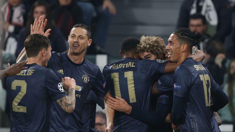 Man Utd celebrate after their late winner against Juventus