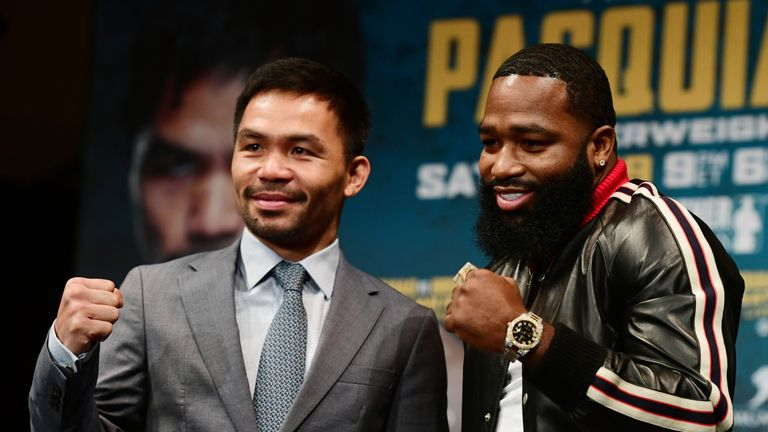 Manny Pacquiao (L) and Adrien Broner face off during a press conference for their upcoming match on January 19