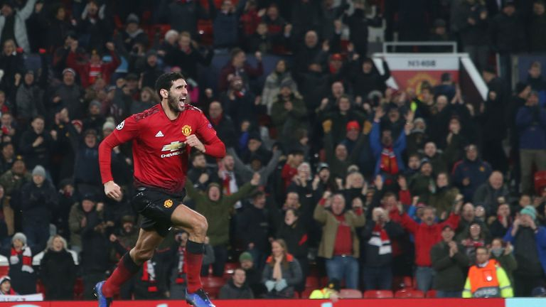 Marouane Fellaini celebrates his last-gasp winner