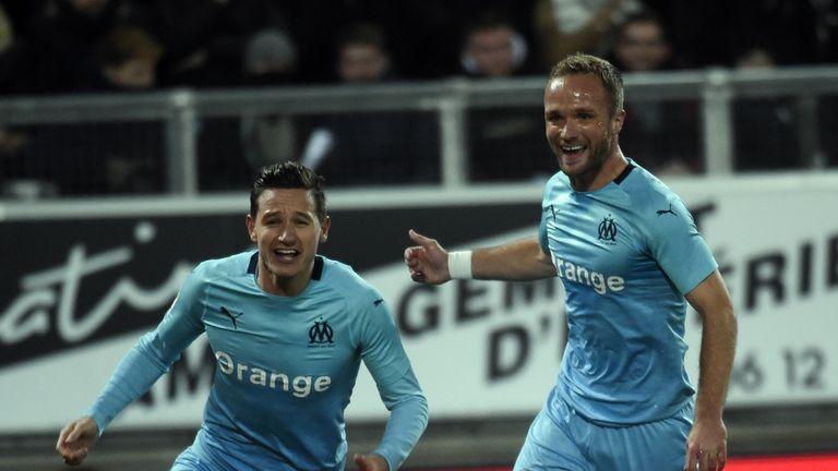 Florian Thauvin (L) fired a hat-trick as Marseille won 3-1 at Amiens