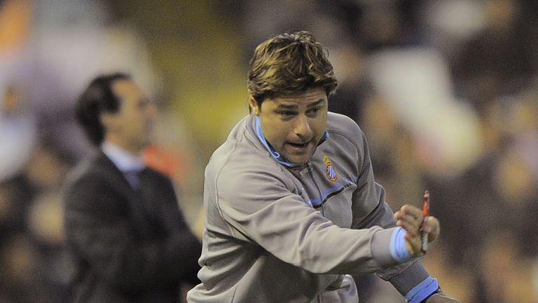 Pochettino during his side's game against Emery's Valencia in January 2011