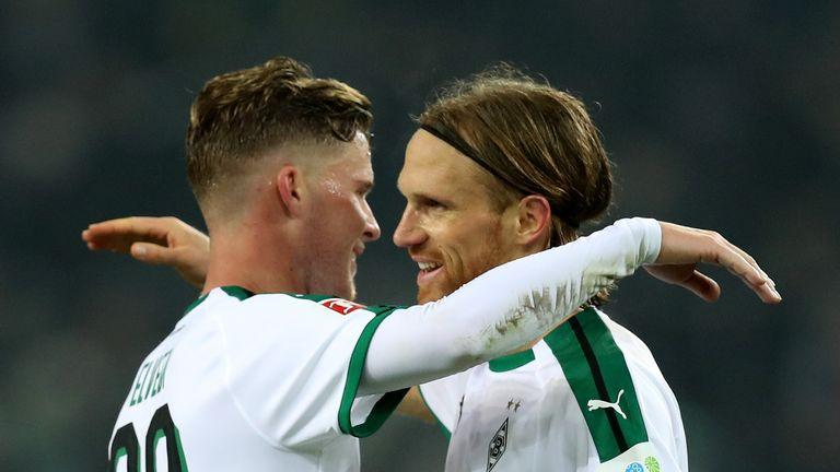 Michael Lang (R) celebrates with team-mate Thorgan Hazard after Borussia Monchengladbach's win