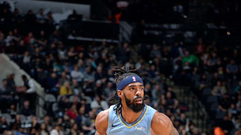 SAN ANTONIO, TX - NOVEMBER 21: Mike Conley #11 of the Memphis Grizzlies handles the ball against the San Antonio Spurs on November 21, 2018 at the AT&T Center in San Antonio, Texas. NOTE TO USER: User expressly acknowledges and agrees that, by downloading and/or using this photograph, user is consenting to the terms and conditions of the Getty Images License Agreement. Mandatory Copyright Notice: Copyright 2018 NBAE (Photos by Mark Sobhani/NBAE via Getty Images)