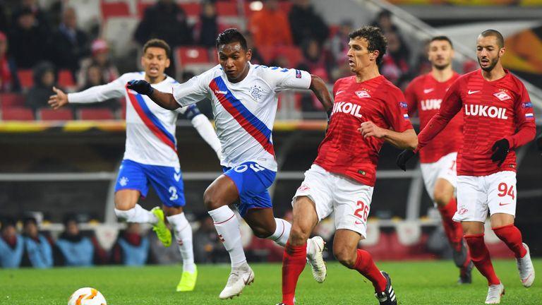 Rangers striker Alfredo Morelos challenges for the ball
