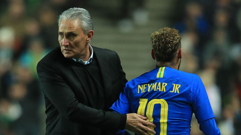 Brazil's Neymar leaves the field injured past manager Tite