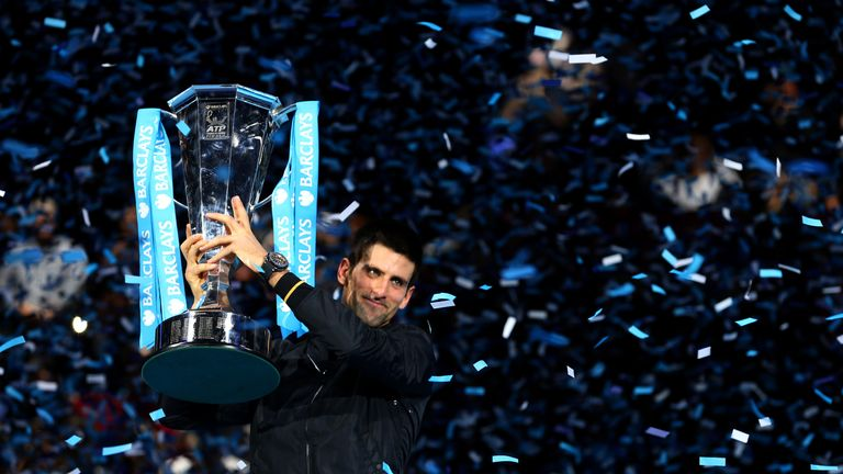Novak Djokovic of Serbia lifts the trophy as he celebrates victory after his men's singles final match against Roger Federer of Switzerland during day eight of the ATP World Tour Finals at O2 Arena on November 12, 2012 in London, England.