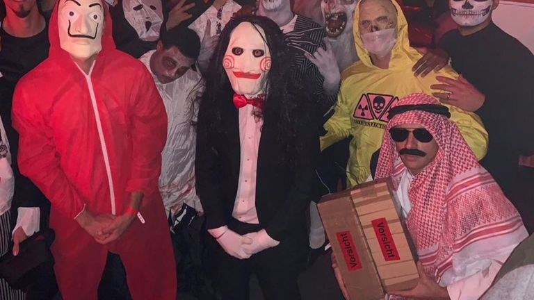 Rafinha dressed as an Arab holding what appears to be a box of explosives for Halloween