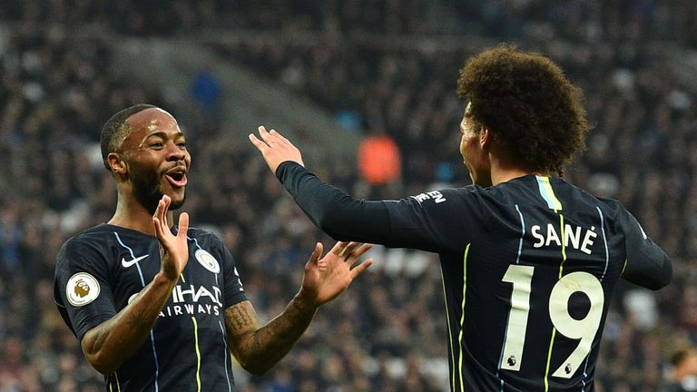 Raheem Sterling celebrates with Leroy Sane after putting Manchester City 2-0 up at West Ham