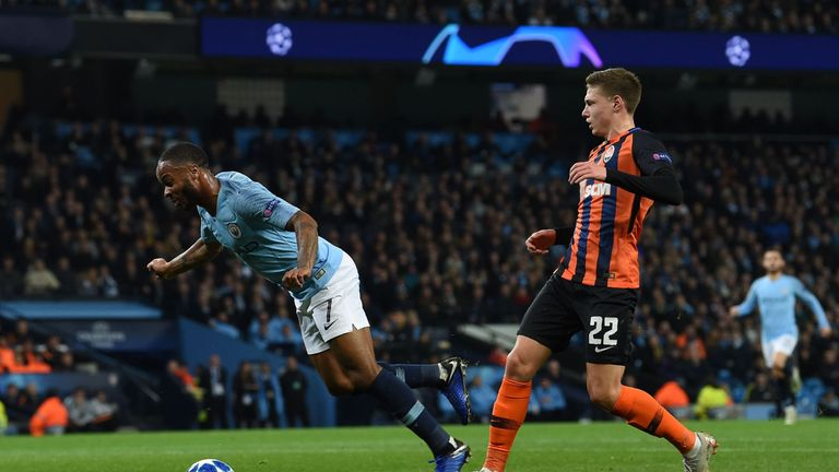 Raheem Sterling kicks the turf before going down in the penalty area