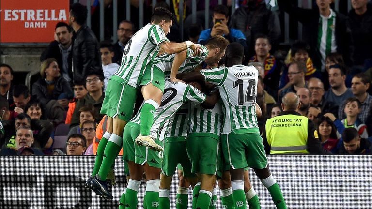 Betis players celebrate their stunning win at the Nou Camp