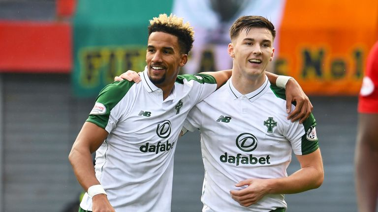 Scott Sinclair (L) celebrates Hamilton's own goal with Kieran Tierney