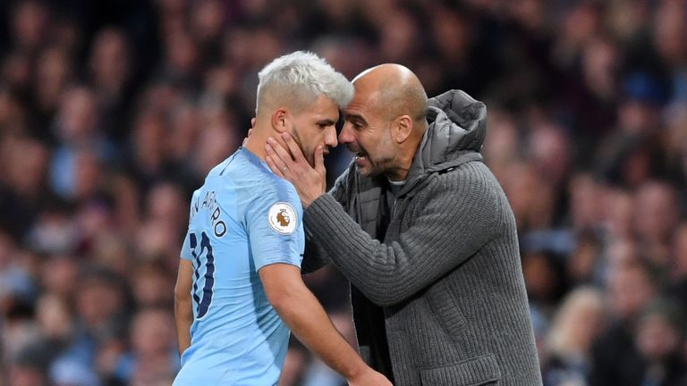 Sergio Aguero is embraced by Pep Guardiola following his substitution