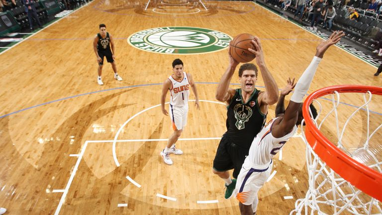 Brook Lopez #11 of the Milwaukee Bucks shoots the ball against the Phoenix Suns on November 23, 2018 at the Fiserv Forum Center in Milwaukee, Wisconsin.