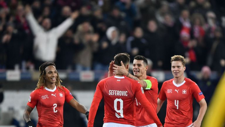 Seferovic is congratulated by Granit Xhaka