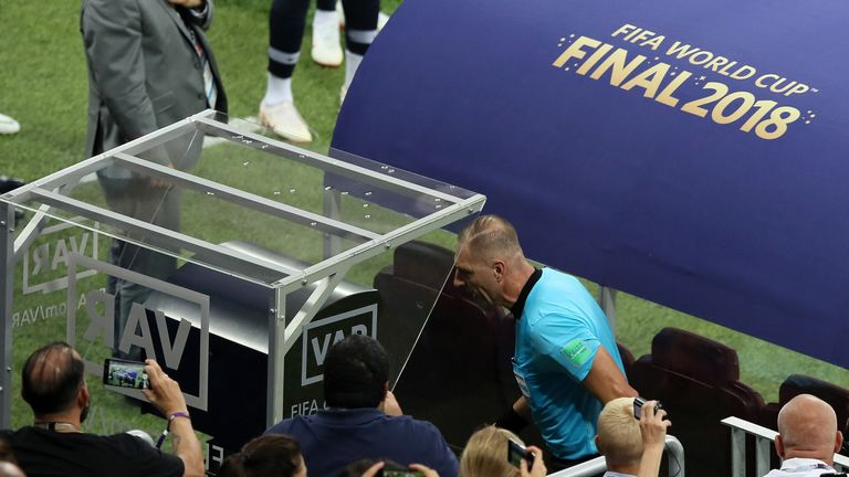 Nestor Pitana consults VAR during the 2018 FIFA World Cup Final between France and Croatia