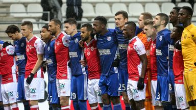 Strasbourg players stand hand in hand with Reims to respect those killed in Tuesday's shooting