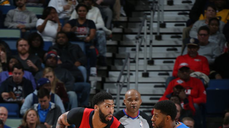 Anthony Davis is guarded by Paul George
