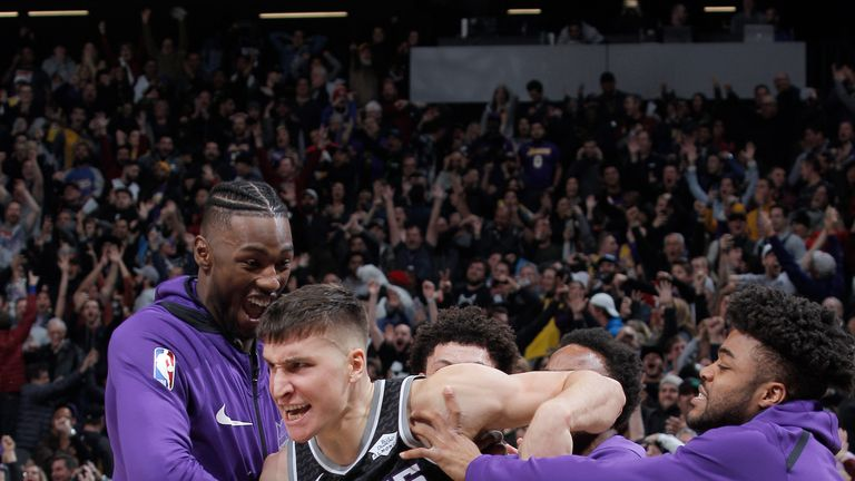 Bogdan Bogdanovic is mobbed by team-mates after hitting a gam-winning three-pointer at the buzzer