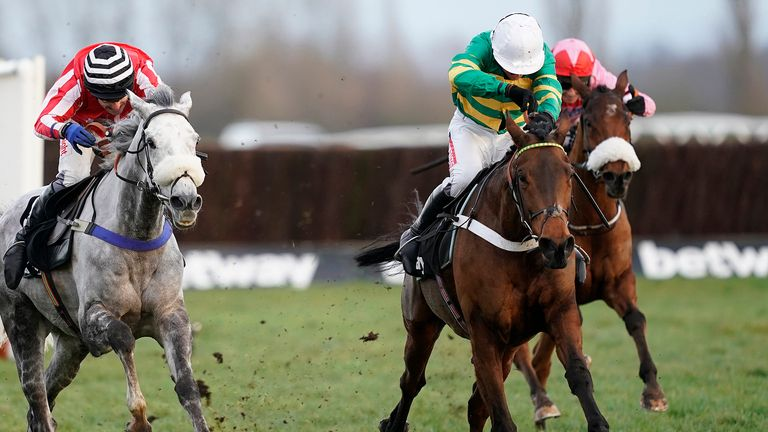 Barry Geraghty riding Champ (green and gold) en route to winning the Challow Hurdle