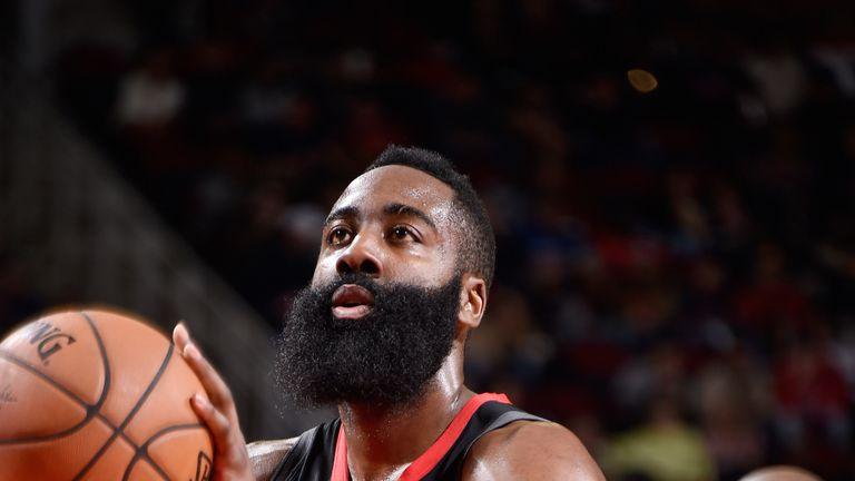 James Harden shoots a free throw against Portland