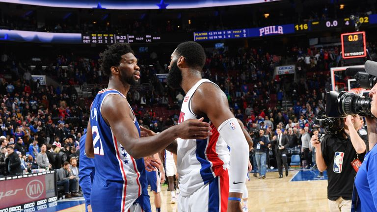 Joel Embiid engages with Andre Drummond after the Sixers beat the Pistons