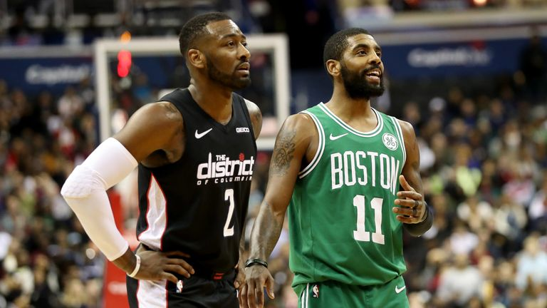 John Wall and Kyrie Irving in action